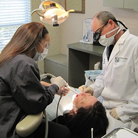 Dr. Hutto treating dental patient