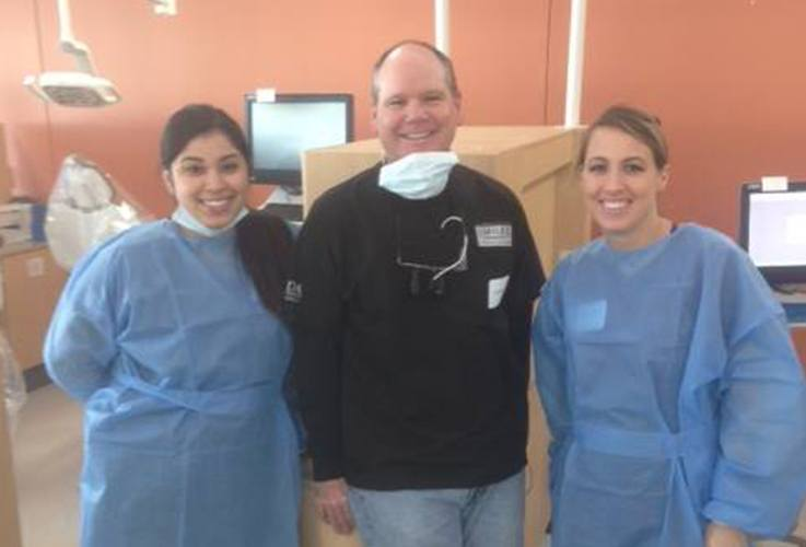 Dr. Hutto and two team members