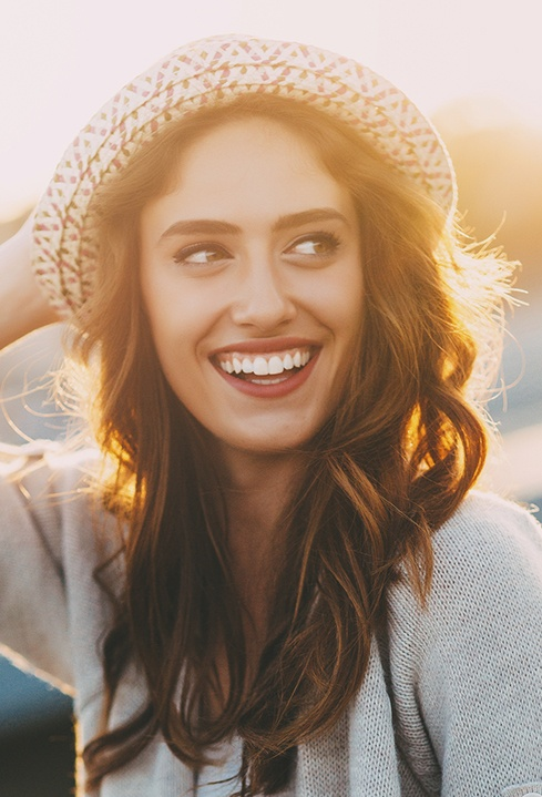 Woman with flawless smile outdoors