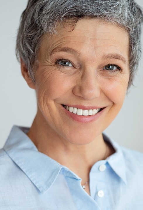 woman smiling with dental implants in Baytown