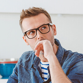 Man contemplating tooth replacement options